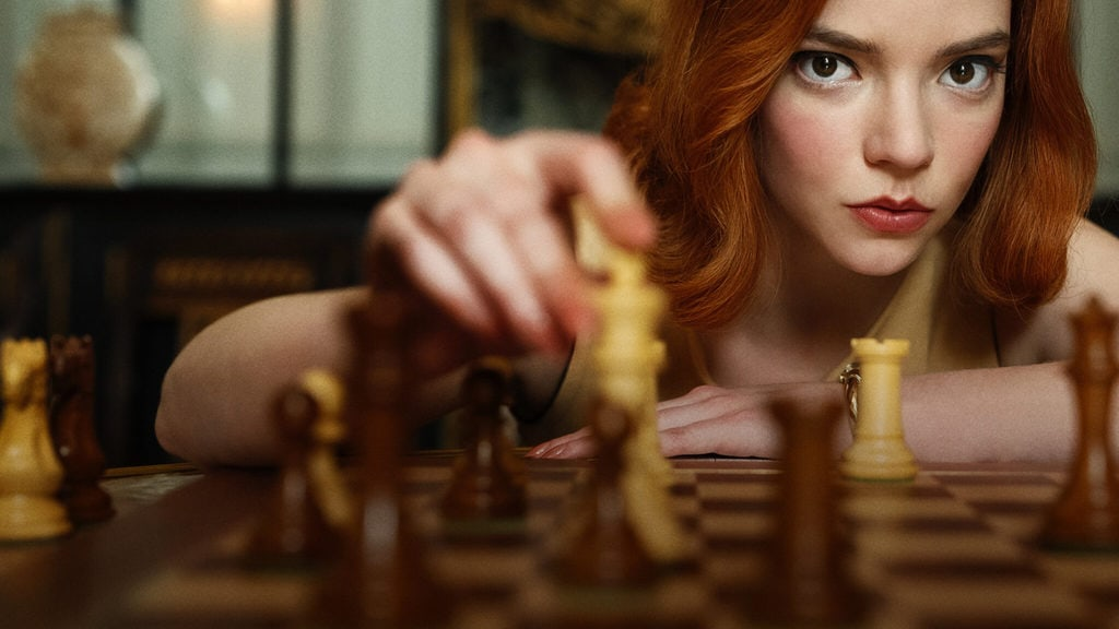 The Queen's Gambit, Beth Harmon playing chess, staring into the camera