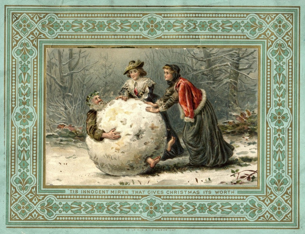 circa 1879: Two women in Stuart costume roll Father Christmas through the woods in a giant snowball, on this unusual Christmas card.